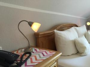 Кровать или кровати в номере Landhaus Göke