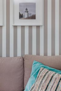 Ein Bett oder Betten in einem Zimmer der Unterkunft Apartament Konik Morski - Apartamenty Vento