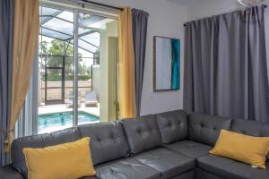 A seating area at Splendid Four Bedroom Close To Disney w/ Pool 4987