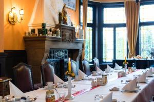 Ein Restaurant oder anderes Speiselokal in der Unterkunft Gästehaus Musmann