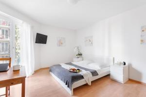 Ein Bett oder Betten in einem Zimmer der Unterkunft Swiss Star Zurich Sihlfeld - contactless self check-in