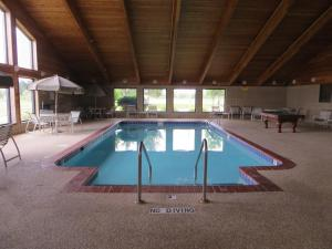 The swimming pool at or near Super 8 by Wyndham Davenport