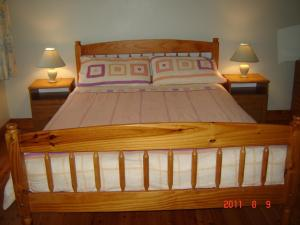 A bed or beds in a room at Drumkeeran Holiday Homes