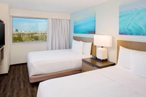 A bed or beds in a room at Hyatt House across from Universal Orlando Resort
