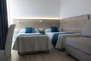A bed or beds in a room at Rocatel