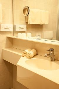 Ein Badezimmer in der Unterkunft Hotel Pension Romantica