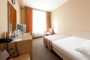 Кровать или кровати в номере Бизнес-Отель Дельта