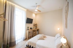 A bed or beds in a room at Ederlezi Boutique Hotel
