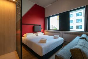 A bed or beds in a room at Via Suites