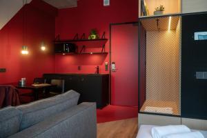 A kitchen or kitchenette at Via Suites