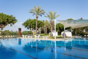 The swimming pool at or near Dan Caesarea Resort