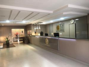 The lobby or reception area at Augusto Palace Hotel