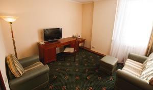 Телевизор и/или развлекательный центр в Шаляпин Палас Отель