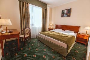 Кровать или кровати в номере Шаляпин Палас Отель