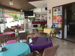 A restaurant or other place to eat at Murat Apart Hotel