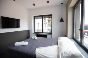 A bed or beds in a room at napoliurbansuite