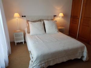Un ou plusieurs lits dans un hébergement de l'établissement Villa Cavalaire