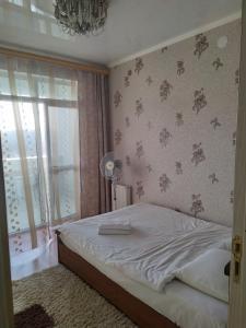 Кровать или кровати в номере Апартаменты «На Горького 87»