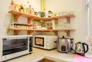 A kitchen or kitchenette at T-Life Hostel