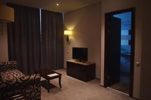 Телевизор и/или развлекательный центр в Отель Форест