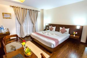 A bed or beds in a room at Kathmandu Suite Home