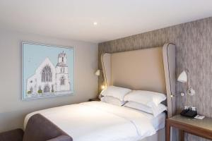 A bed or beds in a room at Cottons Hotel and Spa