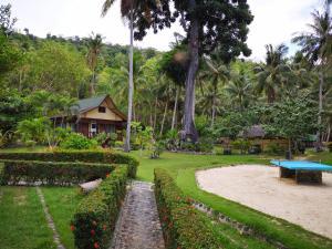 A garden outside Coconut Garden Island Resort