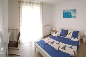 A bed or beds in a room at Apartment Poreč Balota