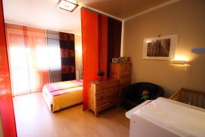 A bed or beds in a room at Villa Mária Apartman