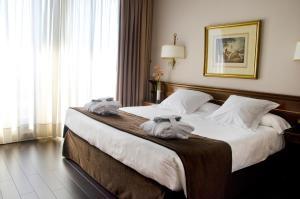 Cama o camas de una habitación en Hotel Miguel Angel