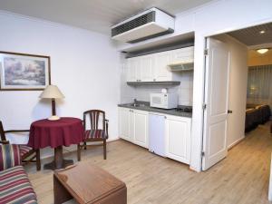 Una cocina o zona de cocina en Apart Hotel Diego De Almagro