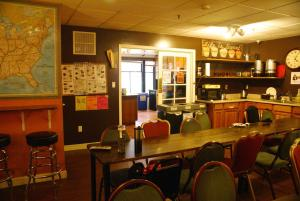 A restaurant or other place to eat at Adelaide Hostel