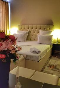 Кровать или кровати в номере Гостевой Дом Черная Жемчужина
