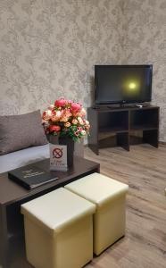 Телевизор и/или развлекательный центр в Гостевой Дом Черная Жемчужина