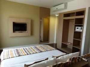 A bed or beds in a room at Mercure Hotel Manaus