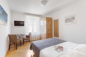 Ein Bett oder Betten in einem Zimmer der Unterkunft Swiss Star Aussersihl - contactless self check-in
