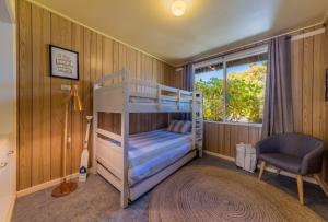 A bunk bed or bunk beds in a room at INVERLOCH BEACH HUT - CLOSE TO BEACH AND SHOPS!