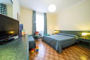 A bed or beds in a room at TH Ortano - Ortano Mare Village