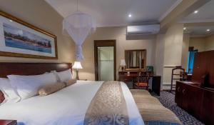 A bed or beds in a room at Sunbird Capital