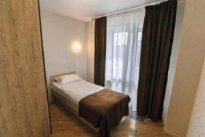 A bed or beds in a room at Raziotel Rishelyevskiy Kherson