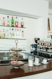 A kitchen or kitchenette at Hotel Houston
