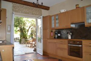 A kitchen or kitchenette at Holidays in Lagrasse