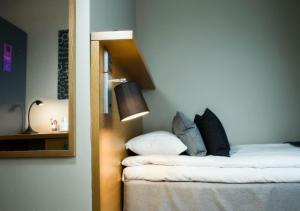 Säng eller sängar i ett rum på Quality Hotel Panorama