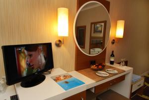 Телевизор и/или развлекательный центр в Oba Star Hotel - Ultra All Inclusive