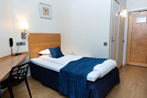 Säng eller sängar i ett rum på Center Hotel- Sure Hotel by Best Western Center