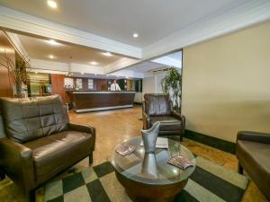 The lobby or reception area at Icaraí Praia Hotel