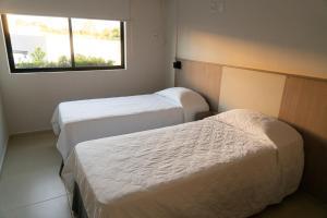 Cama ou camas em um quarto em Iguassu Express Hotel