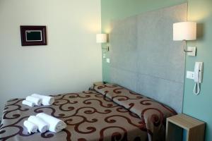 Letto o letti in una camera di Hotel Helga