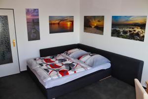 Ein Bett oder Betten in einem Zimmer der Unterkunft Urlaub-Fehmarn-Südstrand