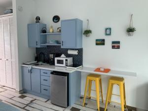 A kitchen or kitchenette at The Beach Pad